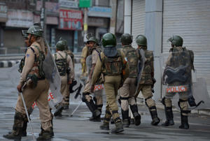 File: Indian paramilitary troopers patrol during a tenth day of curfew in Sringar on July 18, 2016. More than 40 people were killed and over 3,000 injured in disputed Indian-administered Kashmir during a deadly clashes between government forces and demonstrators angered by the killing of a popular young rebel.