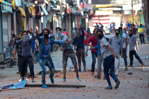 File: Kashmiri Muslim protesters taunt Indian policemen as they clash in Srinaga...