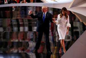 Republican U.S. presidential candidate Donald Trump leaves the stage with his wife Melania after she spoke at the Republican National Convention in Cleveland, Ohio, July 18, 2016.
