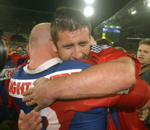 Andrew Johns #7 and team mate Ben Kennedy #12 of the Knights celebrate after the Knights defeated the Eels during the NRL Grand Final between the Parramatta Eels and the Newcastle Knights held at Stadium Australia, Sydney, Australia.
