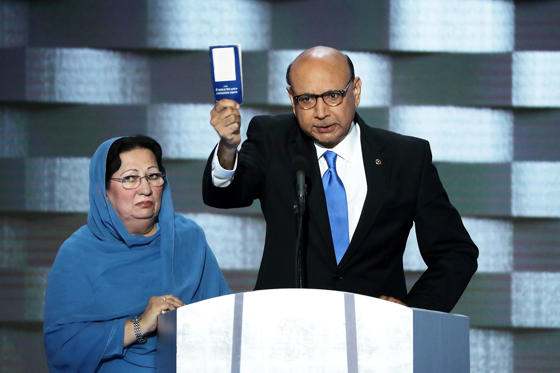 Khizr Khan, father of deceased Muslim U.S. Soldier Humayun S. M. Khan, holds up a booklet of the US Constitution as he delivers remarks on the fourth day of the Democratic National Convention at the Wells Fargo Center, July 28, in Philadelphia, Penn. Democratic presidential candidate Hillary Clinton received the number of votes needed to secure the party's nomination.