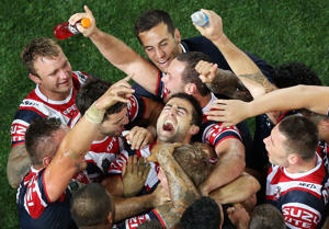 Anthony Minichiello of the Roosters celebrates with team mates at full-time after winning the 2013 NRL Grand Final match between the Sydney Roosters and the Manly Warringah Sea Eagles at ANZ Stadium on October 6, 2013.