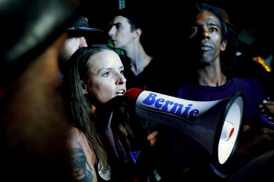 Demonstrators yell during protest at Franklin Delano Roosevelt park in Philadelphia, July 28, during the final day of the Democratic National Convention.