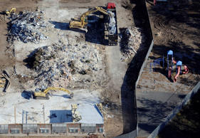 In this Oct. 28, 2013 aerial file photo, workers use backhoes to remove rubble during the demolition of Sandy Hook Elementary School in Newtown, Conn., where gunman Adam Lanza killed 20 children and six adult educators on Dec. 14, 2012.