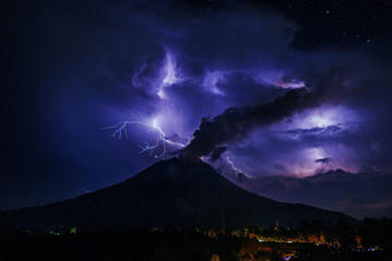 A general view of spewing pyroclastic lava and thunderbolts are seen during Mount Sinabung volcano eruption, seen from Tiga Pancur village in Karo, North Sumatra, Indonesia on July 28, 2016. Areas of Tiga Pancur village and Payung village are covered with volcanic ash.