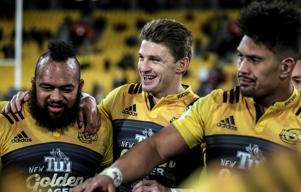 Loni Uhila, Beauden Barrett and Ardie Savea of the Hurricanes celebrate the win during the Super Rugby Semi Final match between the Hurricanes and the Chiefs at Westpac Stadium.