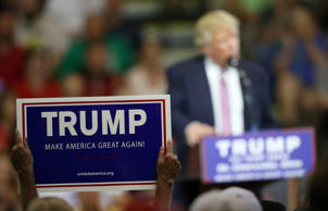 A supporter of Republican U.S. presidential candidate Donald Trump holds up a sign during a campaign rally in St. Clairsville, Ohio June 28, 2016.
