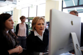 U.S. Democratic presidential candidate Hillary Clinton looks at a computer scree...