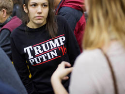 In this Sunday, Feb. 7, 2016 file photo, a woman wears a shirt reading 'Trump Putin '16' while waiting for Republican presidential candidate Donald Trump to speak at a campaign event at Plymouth State University in Plymouth, N.H.