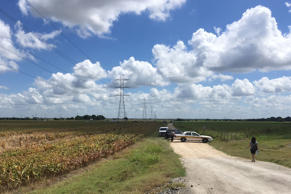 Police cars block access to the site where a hot air balloon crashed early Satur...