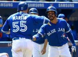 Toronto Blue Jays catcher Russell Martin (55) is greeted by second baseman Devon Travis (29) after scoring against the Baltimore Orioles in the fifth inning at Rogers Centre.