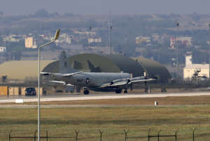 FILE - In this July 28, 2015 file photo, a U.S. Navy plane maneuvers on the runway of the Incirlik Air Base, in Adana, in the outskirts of the city of Adana, southeastern Turkey.