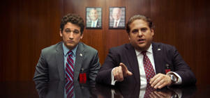 This image released by Warner Bros. Pictures shows Miles Teller, left, and Jonah Hill in a scene from,
