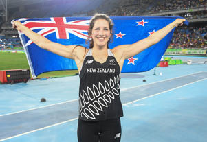 Eliza McCartney celebrates after winning bronze in the pole vault.