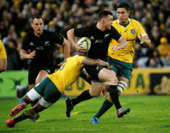 New Zealand's centre Ryan Crotty is tackled by Australia's Will Genia.