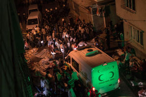 Ambulances arrive at site of an explosion on August 20, 2016 in Gaziantep following a late night militant attack on a wedding party in southeastern Turkey.