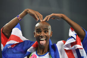 Britain's Mo Farah celebrates after he won the Men's 5000m Final during the athl...