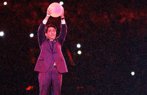 Japan's Prime Minister Shinzo Abe appears during the closing ceremony in the Maracana stadium at the 2016 Summer Olympics in Rio de Janeiro, Brazil, Sunday, Aug. 21, 2016. (AP Photo/Matt Dunham)