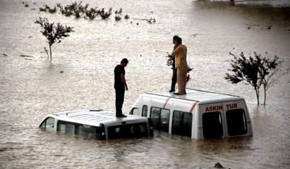 Flooding in Istanbul, Turkey - 09 Sep 2009 People stranded in the flood water.