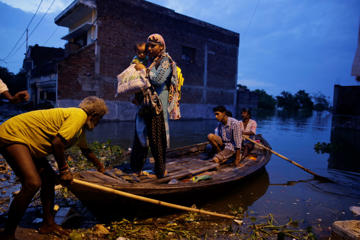 People leave for safer places due to the flooding in the river Ganges in Allahabad, India, Tuesday, Aug. 23, 2016. Days of heavy rain have caused the Ganges River and its tributaries to rise above the danger level during the past 48 hours in about 20 districts of the states of Madhya Pradesh, Bihar and Uttar Pradesh.