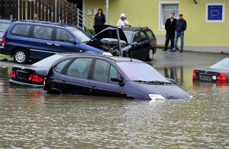 PASSAU, GERMANY - JUNE 03: Parked cars are flooded by the rising Danube river in the historic city center on June 3, 2013 in Passau, Germany. Heavy rains are pounding southern and eastern Germany, causing wide-spread flooding and ruining crops. At least