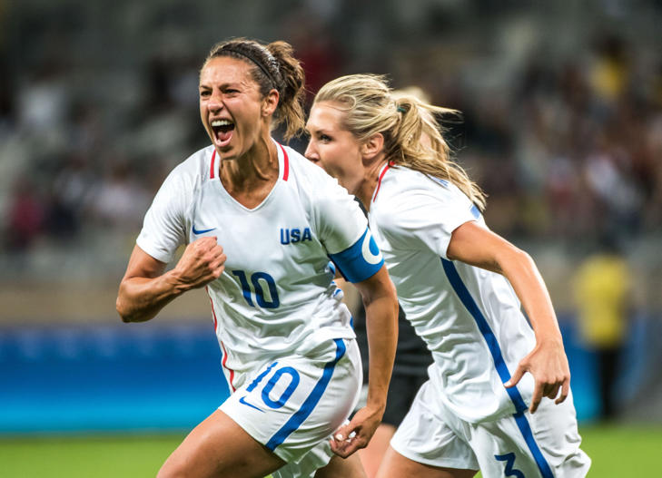 Carli Lloyd (L) of the USA celebrates her goal during a Rio 2016 Olympic Games first round Group G women's football match United States vs New Zealand at the Mineirao stadium in Belo Horizonte, Brazil on August 3, 2016.