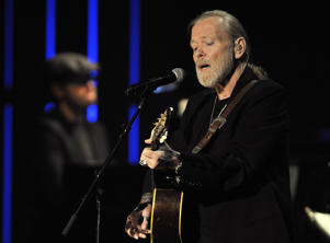 "File- This Oct. 13, 2011, file photo shows Greg Allman performing at the Americana Music Association awards show in Nashville, Tenn. Allman has canceled planned live shows until late October due to ""serious health issues."" In a statement released Friday, Aug. 5, 2016, the 68-year-old Allman says he's currently under his doctor's care at a facility. No more details were provided.(AP Photo/Joe Howell, File)"