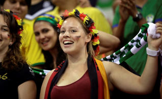 German fans cheer their team during the men's preliminary handball match between Sweden and Germany at the 2016 Summer Olympics in Rio de Janeiro, Brazil, Sunday, Aug. 7, 2016. (AP Photo/Ben Curtis)