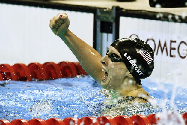 USA's Katie Ledecky celebrates after she broke the World Record in the Women's 400m Freestyle Final during the swimming event at the Rio 2016 Olympic Games at the Olympic Aquatics Stadium in Rio de Janeiro on Aug. 7.