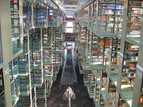 """<p><a href=""""http://mentalfloss.com/article/65383/take-look-inside-mexico-citys-massive-gorgeous-library"""">Biblioteca Vasconcelos</a> spans a whopping 38,000 square meters, and it contains hive-like bookshelves, mismatched floors, and transparent walls, not to mention it holds more than 470,000 books.</p>"""