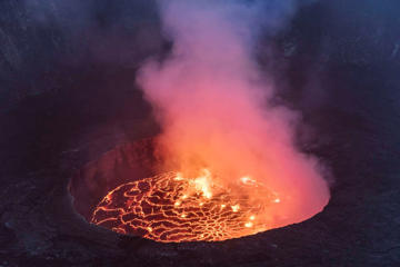 NORTH KIVU, DEMOCRATIC REPUBLIC OF CONGO - 2016/05/20: The lava lake seen from the top of the main crater of Mount Nyiragongo. The Nyiragongo is an active stratovolcano with an elevation of 3,470 metres in the Virunga National Park, about 20 km north of