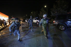 Afghan security forces rush to respond to a complex Taliban attack on the campus...