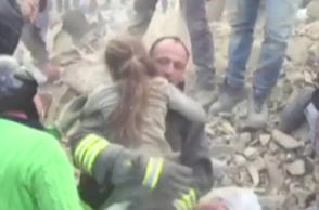 Girl pulled out of rubble