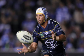 Johnathan Thurston of the Cowboys passes the ball during the round 25 NRL match between the Canterbury-Bankstown Bulldogs and the North Queensland Cowboys at Belmore Sports Ground in Sydney on Thursday, August 25, 2016.
