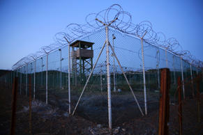 FILE PHOTO - Chain link fence and concertina wire surrounds a deserted guard tower within Joint Task Force Guantanamo's Camp Delta at the U.S. Naval Base in Guantanamo Bay, Cuba March 21, 2016.