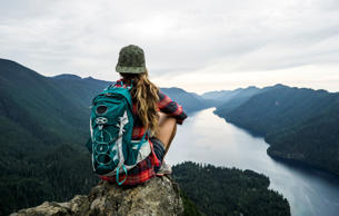 Woman hiking to a scenic viewpoint.