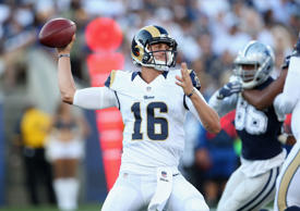 Quarterback Jared Goff #16 of the Los Angeles Rams throws a pass against the Dal...