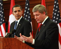 U.S. President Barack Obama, left, speaks during a joint news conference with Stephen Harper