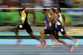 Usain Bolt of Jamaica competes in the men's 100 meter semifinal at the 2016 Game...