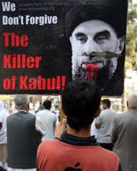 "An Afghan demonstrators holds a placard with an image of Gulbuddin Hekmatyar, the leader of Hizb-i-Islami Gulbuddin party, during a demonstration against him in a public park in Kabul, Afghanistan, Thursday, Sept. 22, 2016. The government has signed a draft peace deal with Hizb-i-Islami Gulbuddin, a designated ""global terrorist"" after lengthy negotiations that could pave the way for a similar accord with the Taliban."