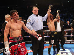 Jorge Linares (second right) celebrates beating Anthony Crolla
