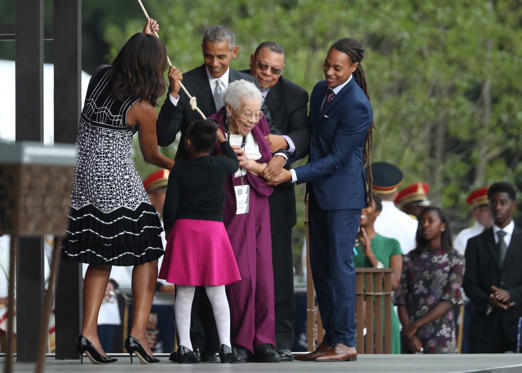 President Barack Obama, with first lady Michelle Obama and Ruth Odom Bonner, center, ring the bell opening the Smithsonian National Museum of African American History and Culture on the National Mall in Washington, Saturday, Sept. 24, 2016. (AP Photo/Man