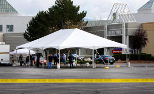 A large tent is set up for enforcement officials in the parking lot of the Cascade Mall on September 24, 2016 in Burlington, Washington. Five people were killed last night when a gunman opened fire in the shopping mall.