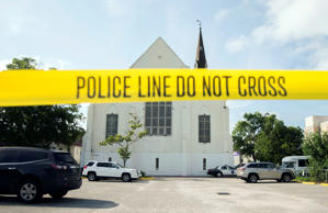 FILE - In this June 19, 2015 file photo, police tape surrounds the parking lot behind the AME Emanuel Church as FBI forensic experts work the crime scene, in Charleston, S.C. Attorneys for the man charged with killing nine people at a Charleston church are challenging federal prosecutors' intention to seek the death penalty against him.