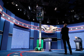 HEMPSTEAD, NEW YORK - SEPTEMBER 25: Workers make adjustments to the set for the first U.S. presidential debate at Hofstra University on September 25, 2016 in Hempstead, New York.