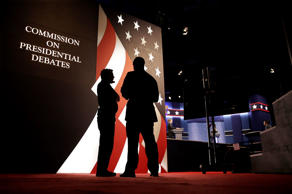 Producers stand next to the stage for the presidential debate between Democratic...