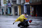 A motorcyclist falls along a road as Typhoon Megi hits Hualien, eastern Taiwan, September 27, 2016.