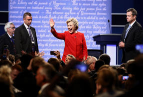 Hillary Clinton, 2016 Democratic presidential nominee, center, waves to attendees after the first U.S. presidential debate at Hofstra University in Hempstead, New York, U.S., on Monday, Sept. 26, 2016.