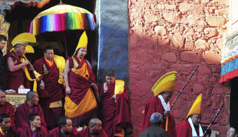 Gyaltsen Norbu (top 4th L), the 11th Panchen Lama, arrives at a Buddhism gathering at the Tashilhunpo Monastery in Shigatse, Tibet Autonomous Region, China, December 8, 2015. Picture taken December 8, 2015. REUTERS/China Daily
