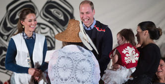 Wearing First Nations vests they were given, Britain's Prince William, the Duke of Cambridge, and Kate, the Duchess of Cambridge, are presented with a doll for Princess Charlotte during a welcoming ceremony at the Heiltsuk First Nation in the remote community of Bella Bella, B.C., on Monday September 26, 2016.